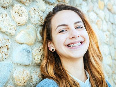 girl smiling in braces